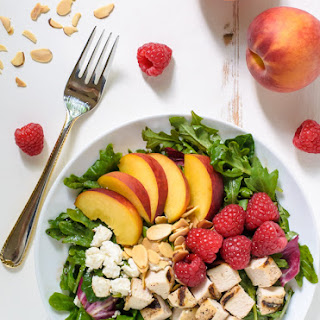 Peach Salad with Grilled Chicken and Raspberries.