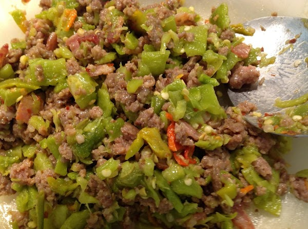 Add drained green chile and mix with the bacon/sausage.