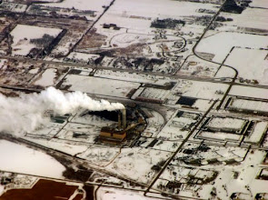 Photo: Air view of factory with smoke stacks