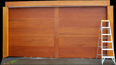 Photo: Sample of our overhead garage door panels can provide you an overhead garage door of any height or length