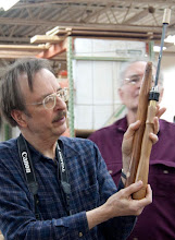 Photo: Gary Guenther shows off his tool handle made from a chair leg.  Here he shows the before-and-after.  This handle incorporates a chuck for utility with a number of steels.  He also noted that wine corks, especially the new plastic ones, can be used to protect the tips of your tools for travel.