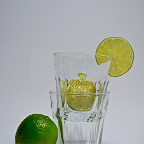 all of them by Anisja Rossi-Ungaro - Artistic Objects Still Life ( glasses, green, white background, yellow, lemon )