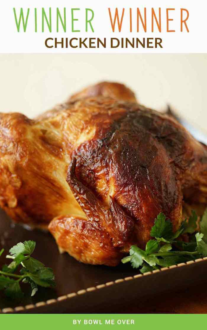 A photo of a roast chicken on a brown platter.