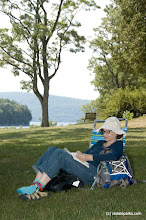 Photo: Michele Volino of NYC, enoys some quiet reading at Kingsland Bay State Park. Photo by Karen Pike