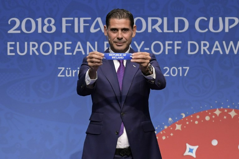 38f02ba79 Spanish retired footballer Fernando Hierro shows the name of Republic of  Ireland during the FIFA football