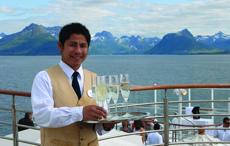 Champagne is served on deck on Silver Explorer in an exotic destination.