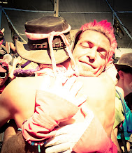 Photo: +John Halcyon Styngives a warm hug at center camp during Burning Man.