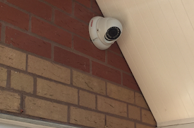 a security camera in a corner of a home