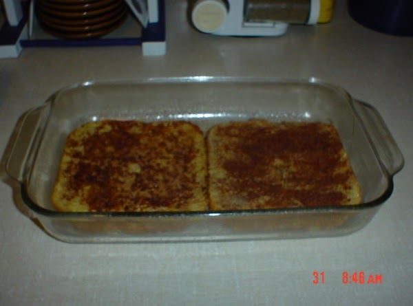Preheat oven to 350F. Meanwhile, make french toast and place 6 slices in bottom...
