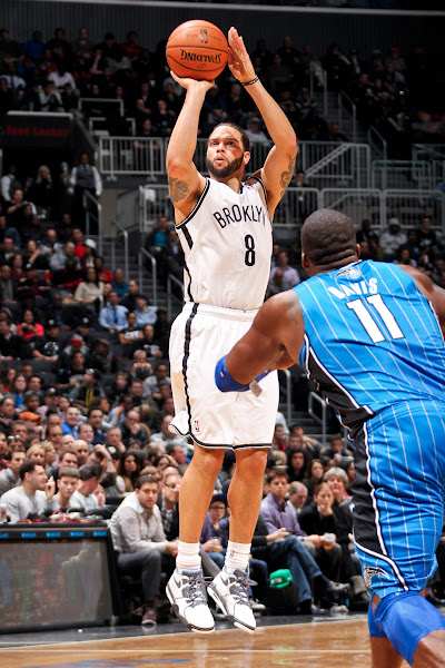 Photo: BROOKLYN, NY - JANUARY 28:  Deron Williams #8 of the Brooklyn Nets shoots against Glen Davis #11 of the Orlando Magic on January 28, 2013 at the Barclays Center in the Brooklyn borough of New York City.  NOTE TO USER: User expressly acknowledges and agrees that, by downloading and or using this photograph, User is consenting to the terms and conditions of the Getty Images License Agreement. Mandatory Copyright Notice: Copyright 2013 NBAE  (Photo by Nathaniel S. Butler/NBAE via Getty Images)