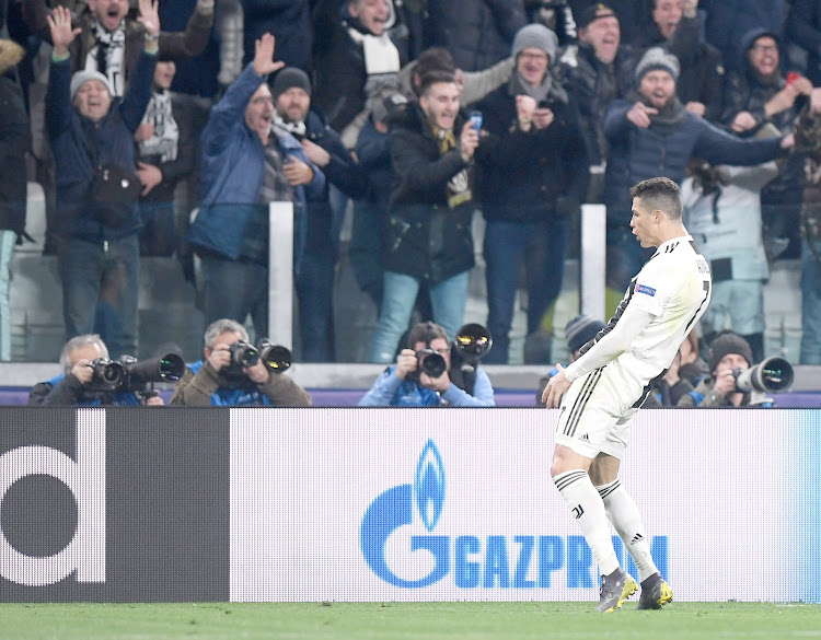 Juventus' Cristiano Ronaldo celebrates after scoring his third goal against Atletico Madrid on Tuesday