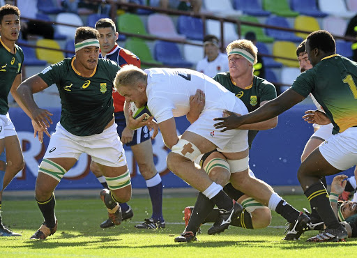 Forward momentum: Josh Coulfield of England is grabbed by SA's Ernst van Rhyn, with Salmaan Moerat, left, in support during Tuesday's World Rugby Under-20 Championship semifinal in Tbilisi. Picture: MARK RUNNACLES/GETTY IMAGES