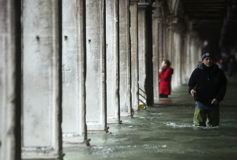 Photo: A man walks through a flooded street during a period of seasonal high water in Venice November 11, 2012. The water level in the canal city rose to 149 cm (59 inches) above normal, according to the monitoring institute.   REUTERS/Manuel Silvestri (ITALY - Tags: ENVIRONMENT SOCIETY TPX IMAGES OF THE DAY)
