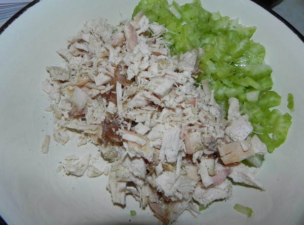 Finely chop your chicken and celery. Next season up your chicken with some beau...