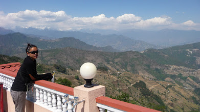 Photo: Emily comtemplating Helambu and Langtang at the rooftop of our lodge in Chisopani