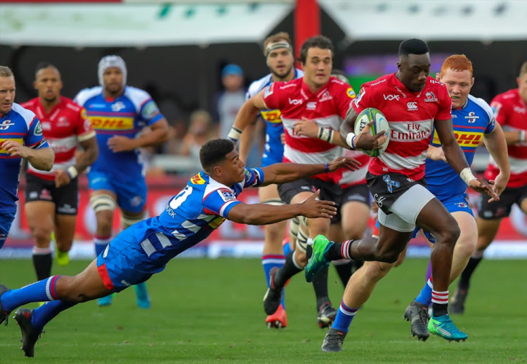 Madosh Tambwe of the Emirates Lions gets away from Damian Willemse of the DHL Stormers on his way to score his first try during the Super Rugby match between Emirates Lions and DHL Stormers at Emirates Airline Park on April 07, 2018 in Johannesburg.