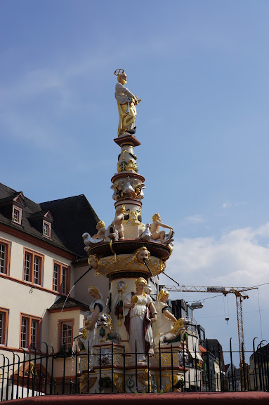 An allegorical fountain found at the marketplace in Trier, Germany (2014)