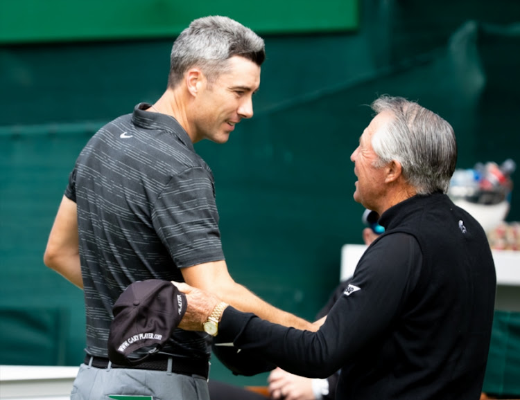 Gary player greets Ross Fisher of England before his start during the day 1 of the 2018 Nedbank Golf Challenge at Gary Player Golf Course on November 08, 2018 in Sun City, South Africa.