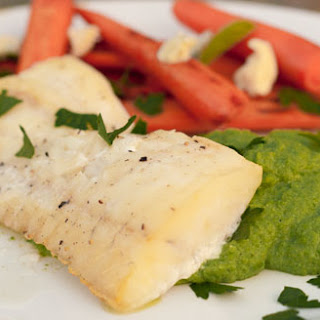 Cedar Plank Grilled Cod served over Pea Puree with Caramelized Carrots
