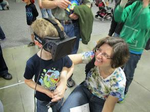 Photo: Kids Enjoying Roller Coaster Virtual Reality Simulation