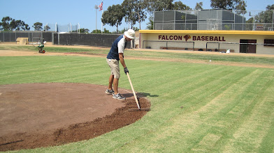 Photo: Now time to tie in the mound edges w/ the new sod.