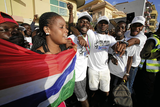 Supporters of president-elect Adama Barrow celebrate his inauguration at Gambia's embassy in Dakar, Senegal on January 19 2017. Picture: REUTERS