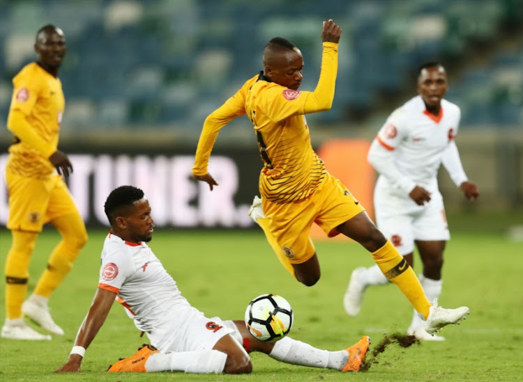 Khama Billiat of Kaizer Chiefs and Edgar Manaka of Polokwane City during the Absa Premiership match between Kaizer Chiefs and Polokwane City at Moses Mabhida Stadium on October 06, 2018 in Durban, South Africa.