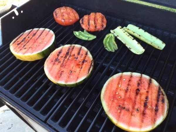 Remove the rind from the two slices of watermelon and cut into chunks. Remove...