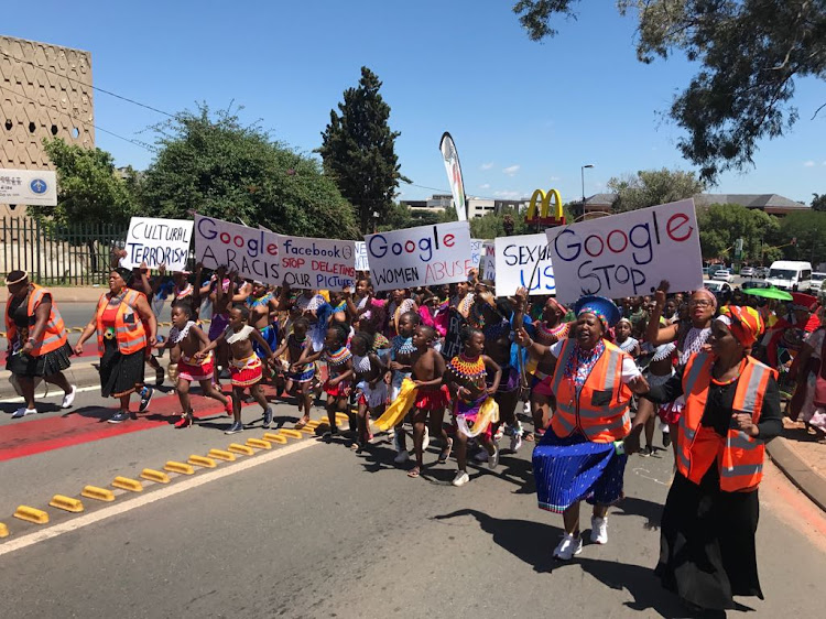 Young girls marched through the streets of Johannesburg on Wednesday, demanding Google and Facebook to stop censoring African culture.