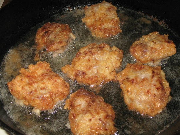 With tongs or a fork, bread loin slices in flour mixture, then brown on...