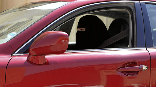 A woman drives a car in Saudi Arabia in 2013, in defiance of a ban that has only just been dropped. Picture: REUTERS