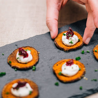 Sweet Potato Crisps with Chive Creme Fraiche and Cranberries.
