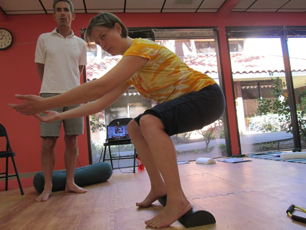 woman squatting with arms extended forward