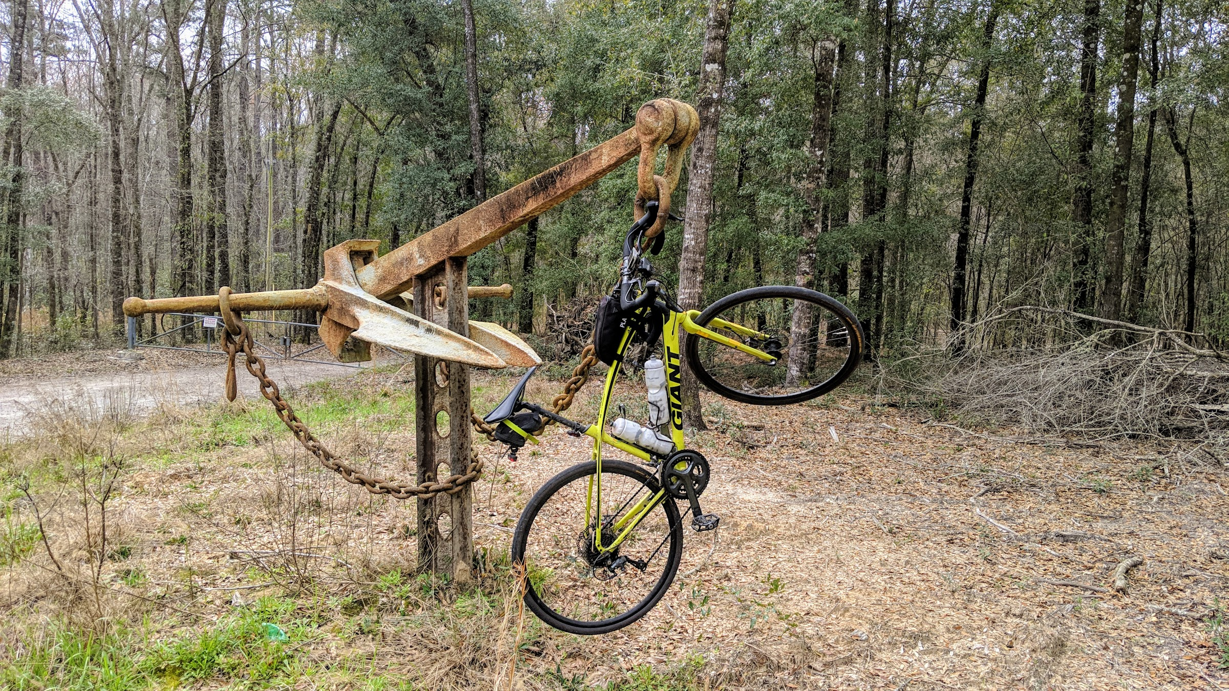 Bike hanging from an ship anchor