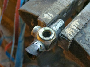 Photo: Finally the brake bridge gets another stainless washer for the brake mount, again to prevent any chipped paint.
