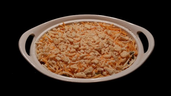Smooth out the top and top with remaining cheese and crushed crackers of your...