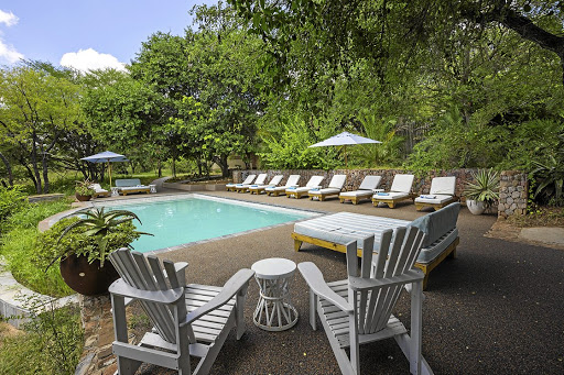 Secluded: Vegetation surrounds the pool at Thornybush Game Lodge, a private game reserve. Picture: SUPPLIED