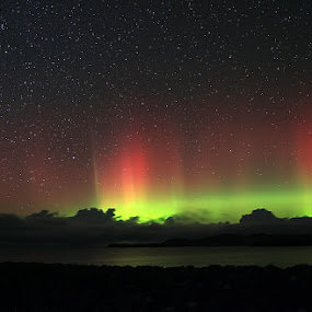 Aurora Borealis from Scotland by Steve BB - City,  Street & Park  Skylines ( clouds, scotland, pwcstars, green, northern lights, aurora, sea, yellow, seascape, landscape, astronomy, rays, lightshow, red, borealis, stars, vista, night, natural, lightscape, beach )