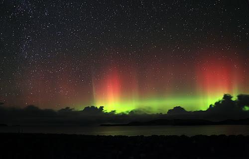 Aurora Borealis from Scotland by Steve BB - City,  Street & Park  Skylines ( clouds, scotland, pwcstars, green, northern lights, aurora, sea, yellow, seascape, landscape, astronomy, rays, lightshow, red, borealis, stars, vista, night, natural, lightscape, beach )