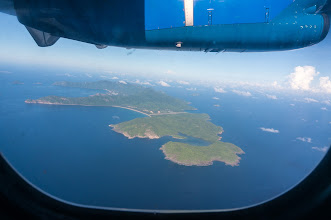 Photo: the archipelago from air, straight horizontal line is the airstrip runway