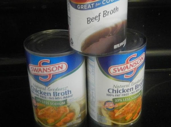 Combine the 3 cans of broth into a saucepan, and bring to a boil.