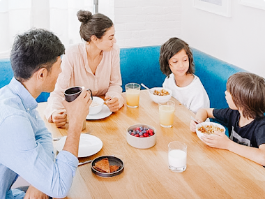 Family eating breakfast without phones