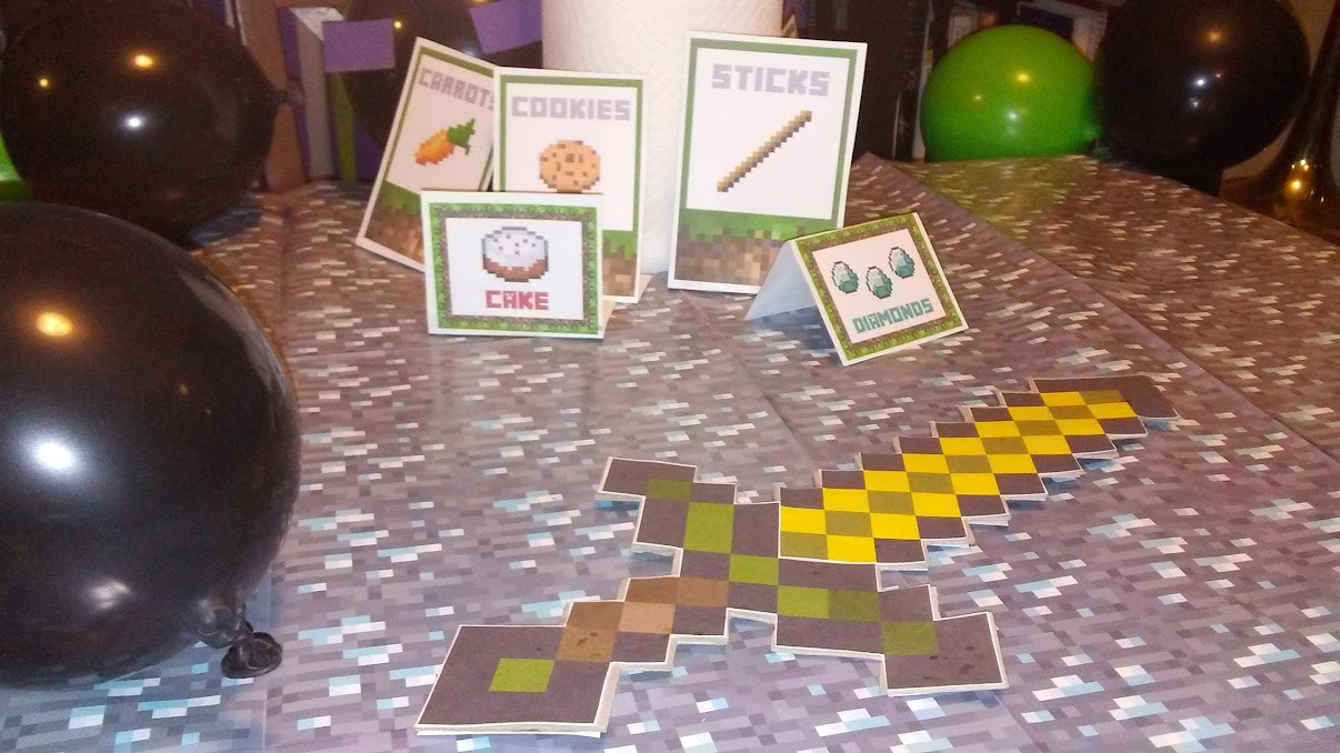 The cards represent the birthday menu ... kind of. My wife even made the sword from card stock. Notice the tablecloth? Yeah, that's diamond ore.
