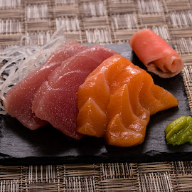 sushi on slate and mat by Burdell Edwin - Food & Drink Plated Food ( mat, lunch, tuna, wasabi, japan, restaurant, asia, asian, chopsticks, salmon, rice, dinner, food, chinese, japanese, china, sushimi, fish, sushi, rice mat, breakfast )