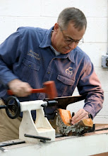 Photo: Enough talk -- to the lathe. After disassembling the puzzle pieces of wild cherry, Warren gets down to hammering in a spur center.