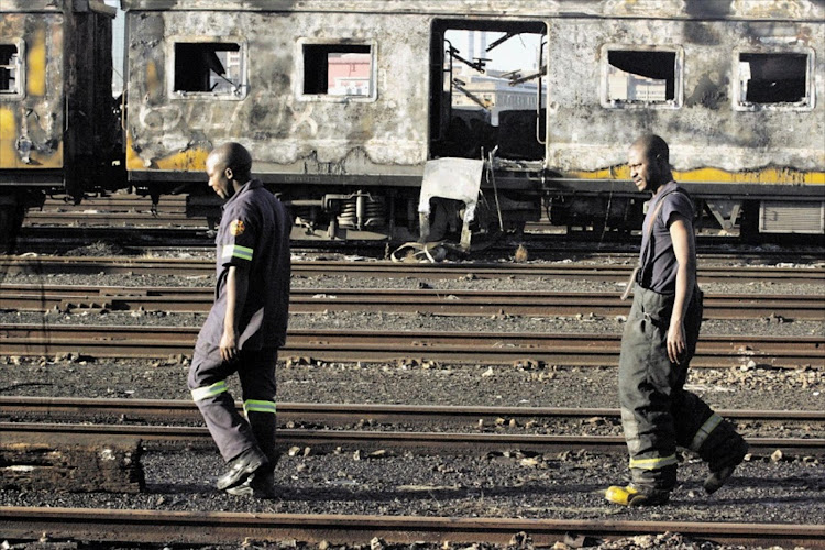 Disgruntled commuters have destroyed scores of trains, with Prasa not doing enough to protect passengers, according to #UniteBehind. Picture SOWETAN