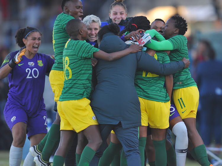Banyana Banyana striker Jermaine Seoposenwe is swamped by teammates as they celebrate her goal that gave SA a crucial 1-0 win over Botswana during the Cosafa Women's Championship group match at the Wolfson Stadium in Port Elizabeth on Friday September 14 2018.