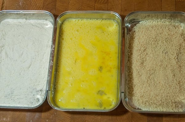 Combine the flour and pepper in a large plate, or breading pan. Whisk the eggs...