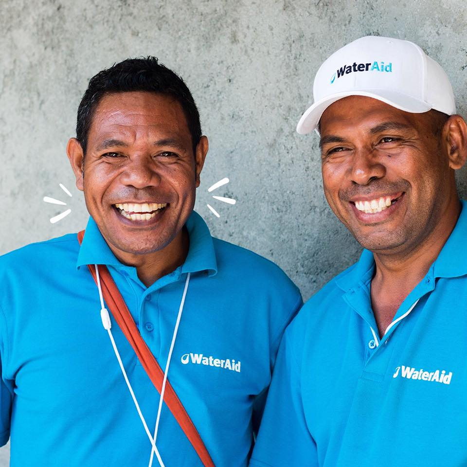 Men in WaterAid shirts
