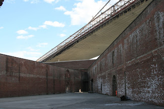 Photo: And old, roofless warehouse (nowadays used for parties and events) with the Brooklyn Bridge overhead.